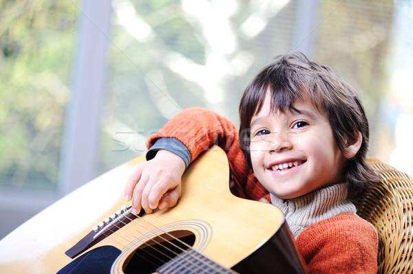 My son playing guitar at home Stock photo © zurijeta
