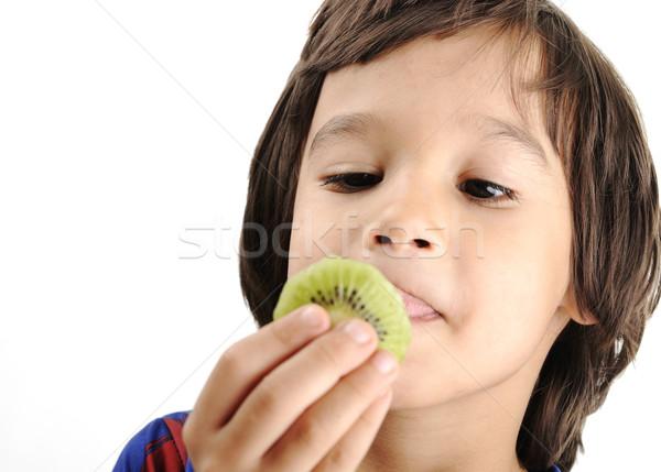 Young boy eating kiwi Stock photo © zurijeta
