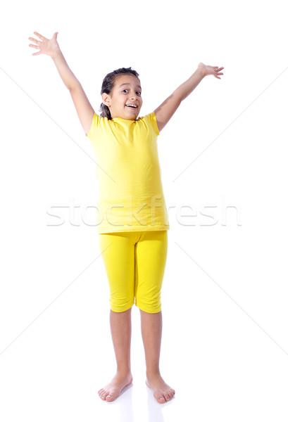 Güzel sevimli kız sarı elbise yalıtılmış Stok fotoğraf © zurijeta