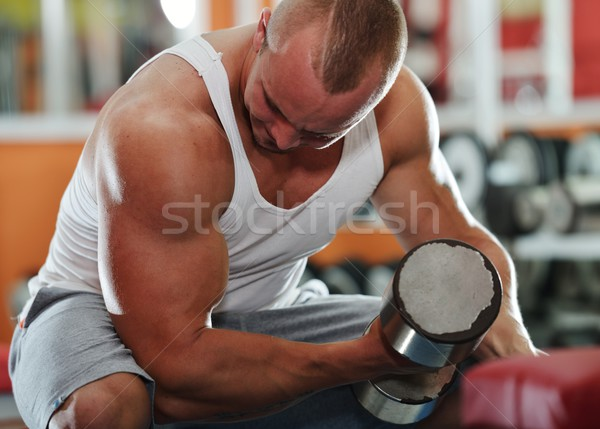 Stock photo: Athletic bodybuilder, execute exercise in sport gym hall