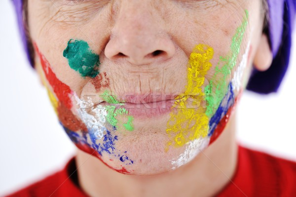 Elderly woman grandmother with painted face over white backgroun Stock photo © zurijeta