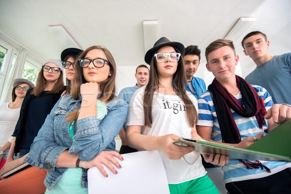 Csoport osztálytársak pózol szemüveg osztályterem diák Stock fotó © zurijeta