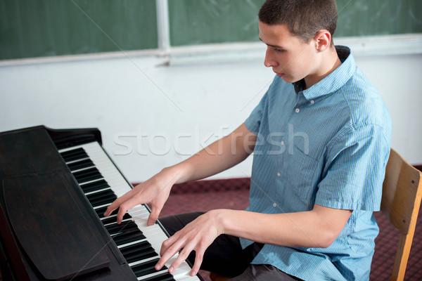 Young student performing Stock photo © zurijeta