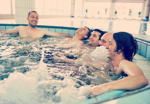 Grupy młodych narodów basen jacuzzi Zdjęcia stock © zurijeta