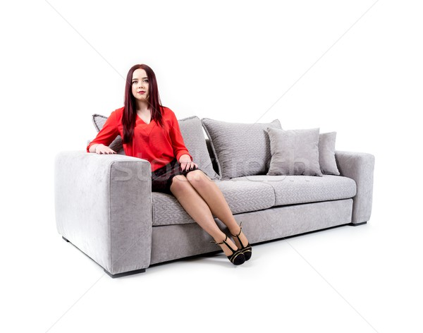 Beautiful girl on couch isolated Stock photo © zurijeta