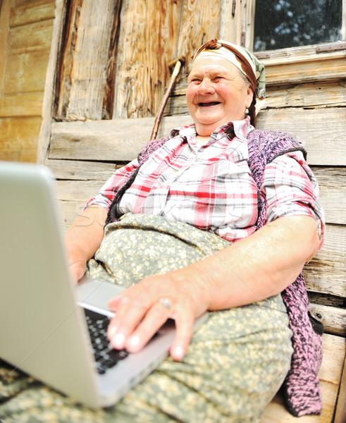Idős kopott nő laptop fa fal Stock fotó © zurijeta