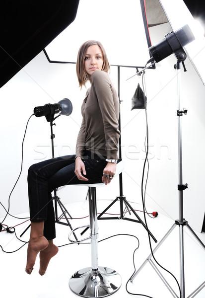 Young beautiful model posing in professionally equipped studio Stock photo © zurijeta