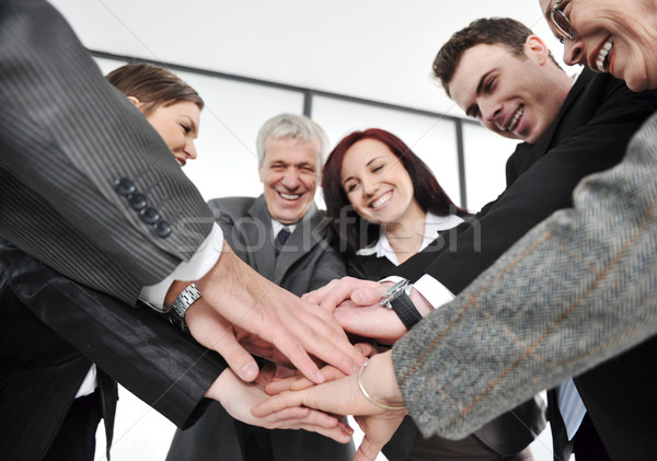 Group of executives placing their hands together Stock photo © zurijeta