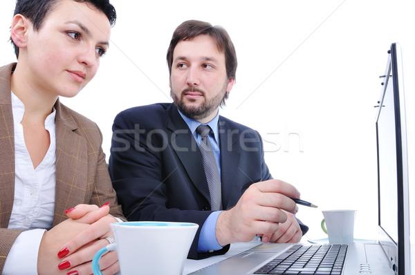 Dos personas oficina portátil negocios mujer cuaderno Foto stock © zurijeta