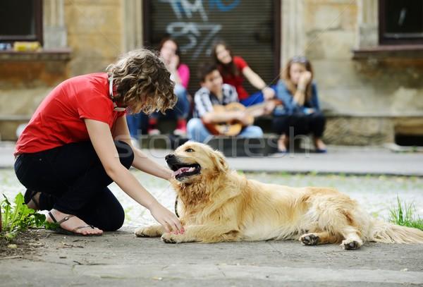 Fiatal valódi emberek utca kutya városi elegáns Stock fotó © zurijeta