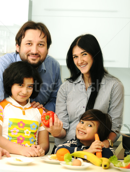 Happy family of four members in kitchen Stock photo © zurijeta