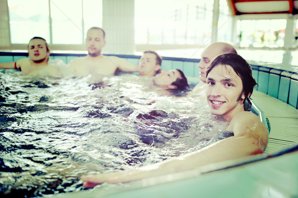 Group of young peoples enjoying on pool and jacuzzi Stock photo © zurijeta