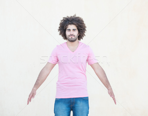 Stock photo: Portrait of young attractive guy with open arms