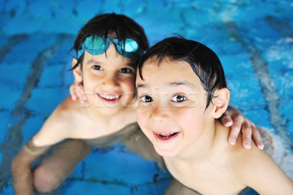 Nyáridő úszik tevékenységek boldog gyerekek medence Stock fotó © zurijeta