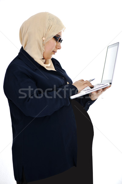 Pregnant Muslim Arabic woman using laptop Stock photo © zurijeta