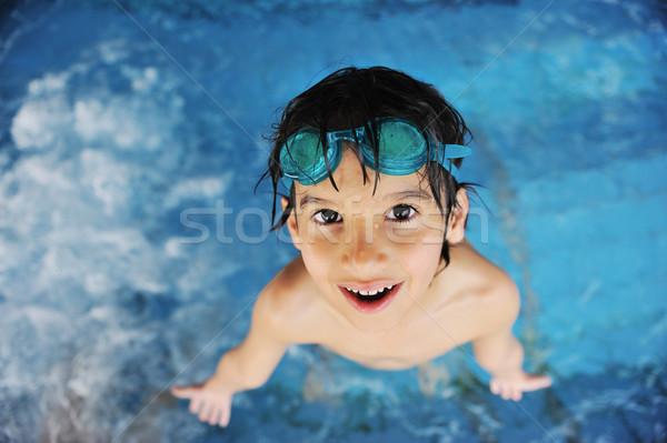 Little cute boy at pool Stock photo © zurijeta
