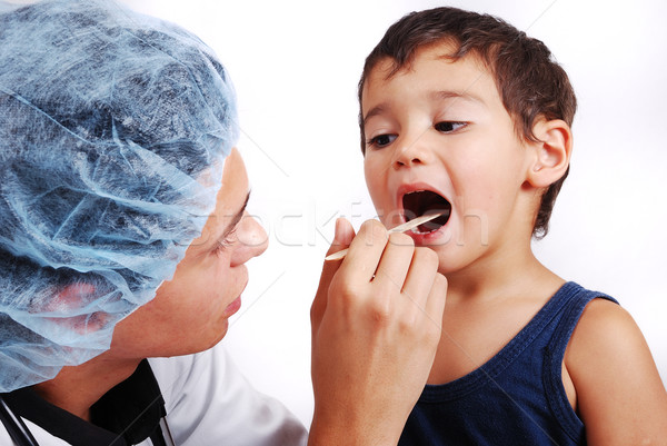 Young male doctor is taking care of little cute kid Stock photo © zurijeta