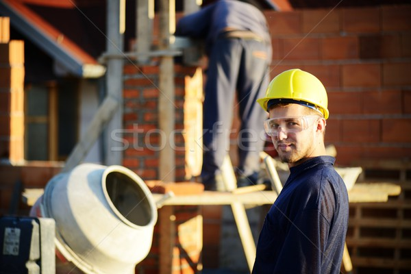 Building under construction with workers Stock photo © zurijeta