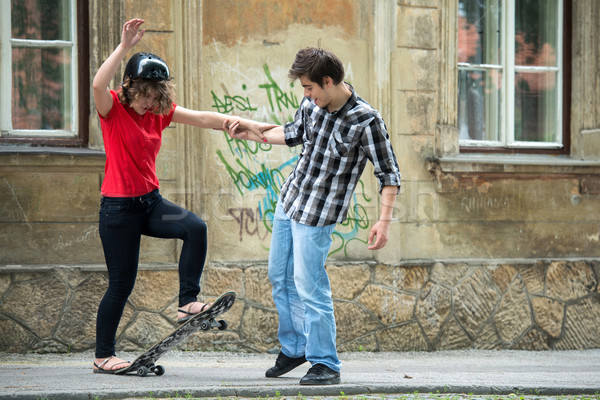 Teenager giving skateboarding instructions Stock photo © zurijeta