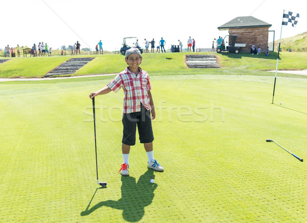 Kid playing golf at club Stock photo © zurijeta