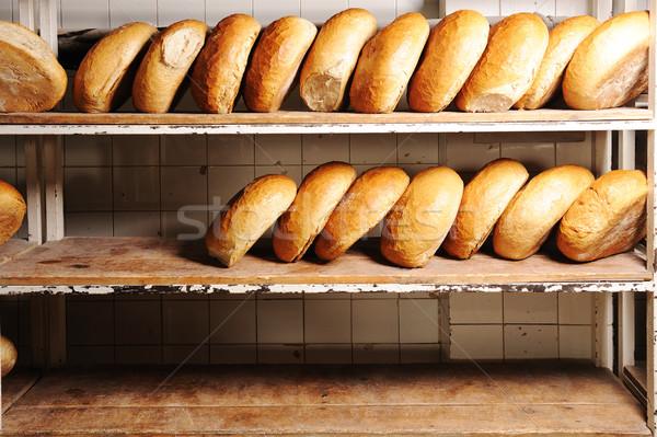 Stock photo: Rows of fresh bread loafs lying on the shelf