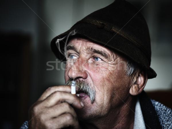 Closeup Artistic Photo of Aged Man With  Grey Mustache Smoking, grain added Stock photo © zurijeta