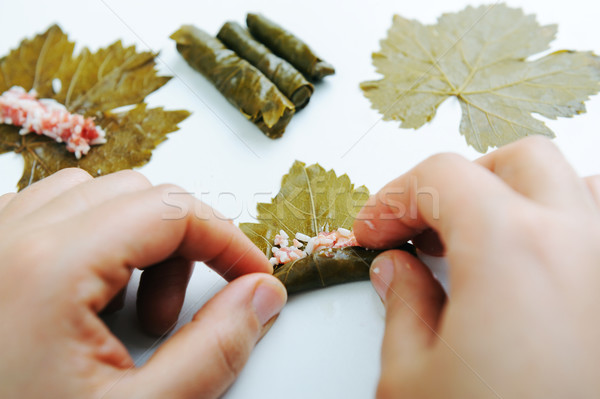 Homemade food in pot prepared for cooking by hands, vegetable filled with a meat, grape leaves  Stock photo © zurijeta