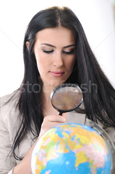 Jovem bela mulher lupa terra mapa Foto stock © zurijeta
