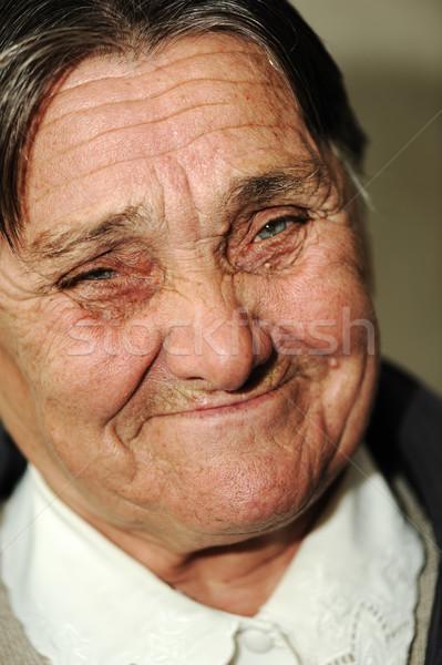 Portret starsza kobieta zielone oczy szczęśliwie uśmiechnięty kobieta Zdjęcia stock © zurijeta