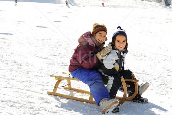 Happy children sledding on snow, mountaint park Stock photo © zurijeta