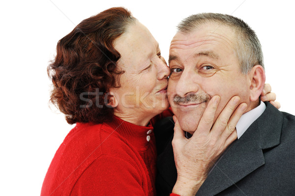 Senior woman kissing in a cheek her husband isolated over white  Stock photo © zurijeta