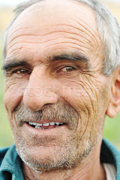 Arc portré ráncos derűs mosolyog idős Stock fotó © zurijeta