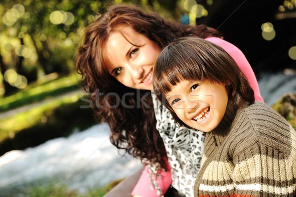 Mom and kid in nature beside the river Stock photo © zurijeta
