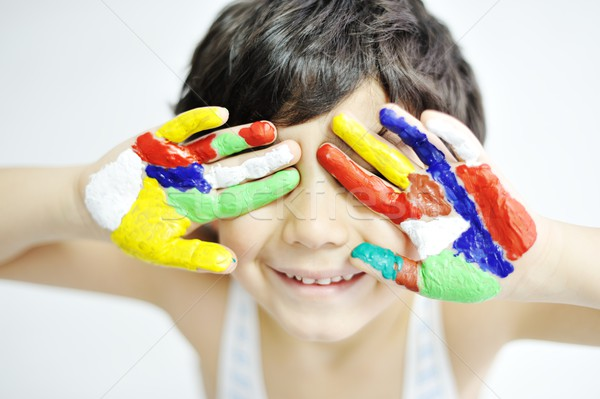 Little boy with hands painted in colorful paints ready for hand  Stock photo © zurijeta