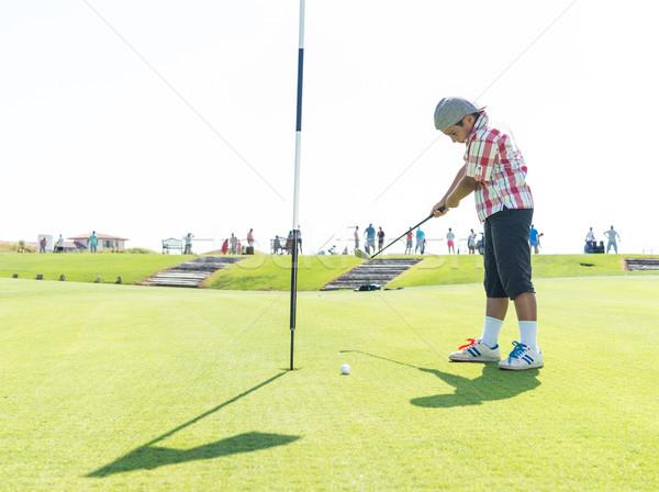 Kid playing golf at club Stock photo © zurijeta