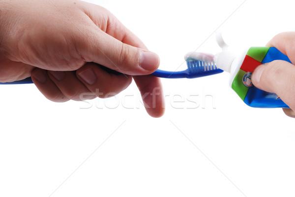 Dentifrice and brush in hands Stock photo © zurijeta