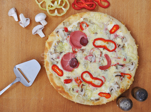 A hot, delicious  pizza with hot and bubbly cheese  Stock photo © zurijeta