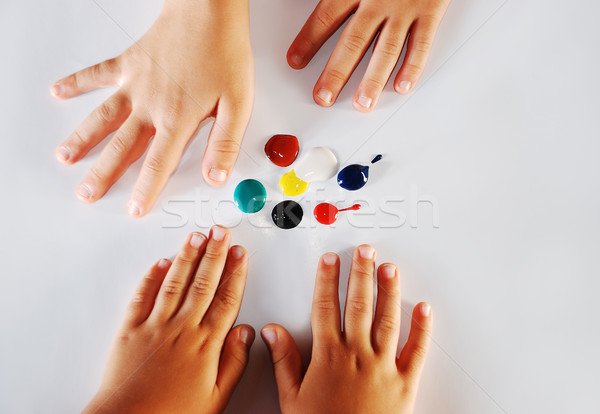 Children little hands playing with colors on white background Stock photo © zurijeta