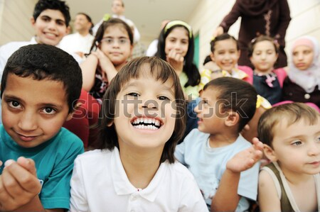 Large group of happy children, different ages and races, crowd Stock photo © zurijeta