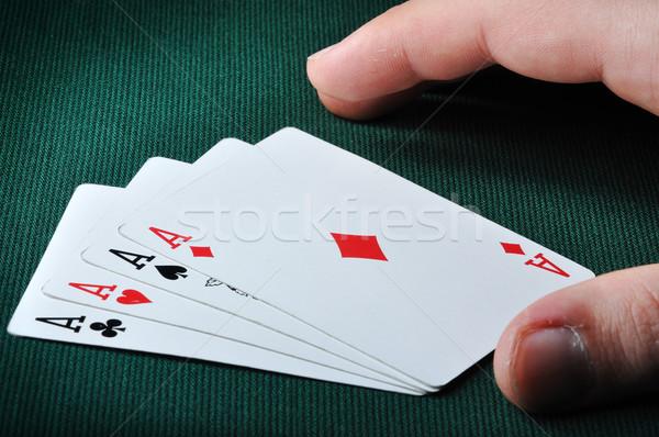 Kártya játékos kéz négy ászok kaszinó Stock fotó © zurijeta