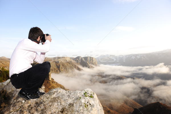 Young professional man with camera shooting outdoor, fantastic landscape Stock photo © zurijeta