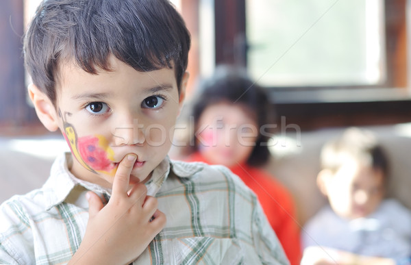 Cute kid with paints in the room Stock photo © zurijeta