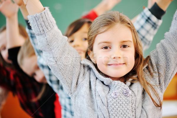 Aranyos iskolások osztályterem oktatás iskola csoport Stock fotó © zurijeta