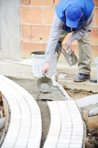 Сток-фото: каменщик · работник · тротуаре · тротуар · каменные