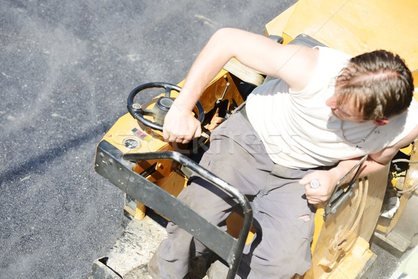 Hard work on asphalt construction Stock photo © zurijeta