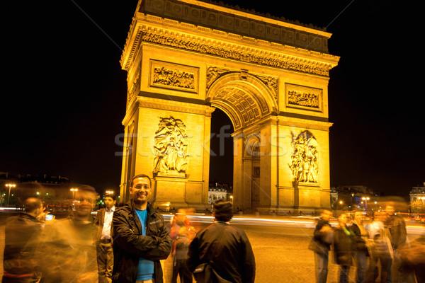Man posing in front of Triumphal Arc Stock photo © zurijeta