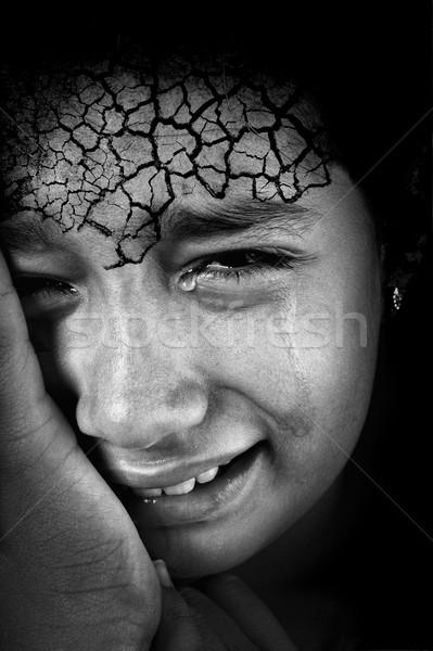 Crying girl with cracked forehead skin Stock photo © zurijeta