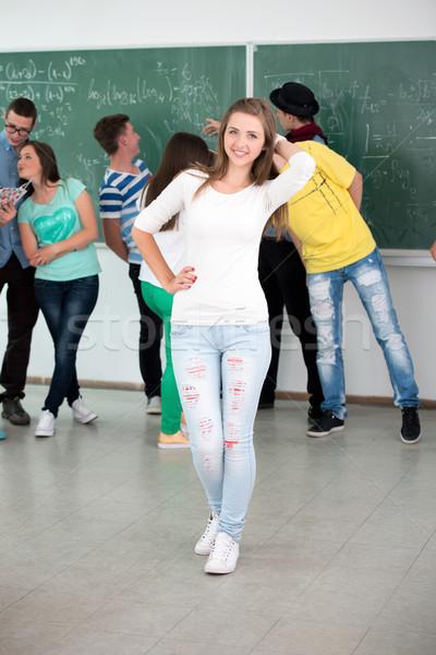 Iskolás lány pózol osztályterem zöld tábla diák Stock fotó © zurijeta