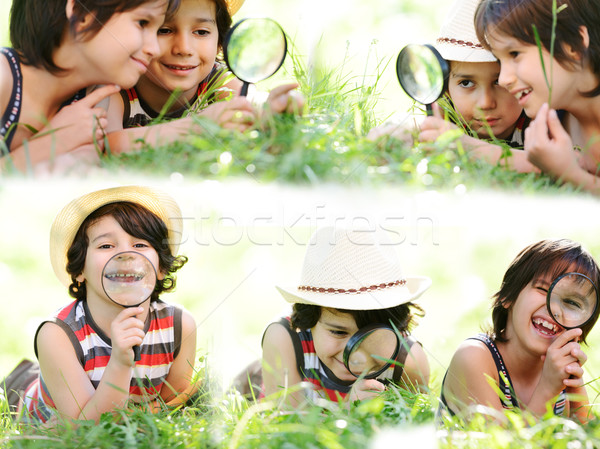 Little explorers playing and learning in grass with fun and happ Stock photo © zurijeta