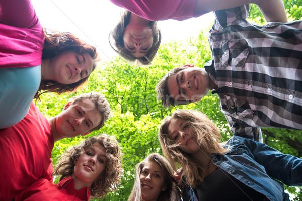 Smiling adolescents looking down Stock photo © zurijeta